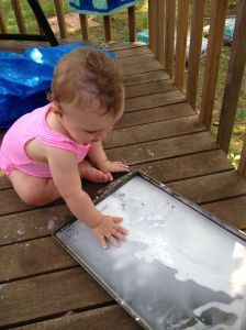 A cookie sheet, cornstarch and water are all you need for smily goop fun!