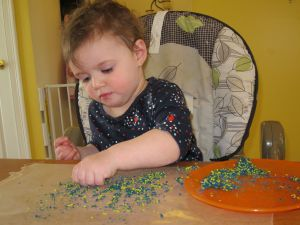 Have little ones sprinkle the shavings onto a piece of taped down wax paper.