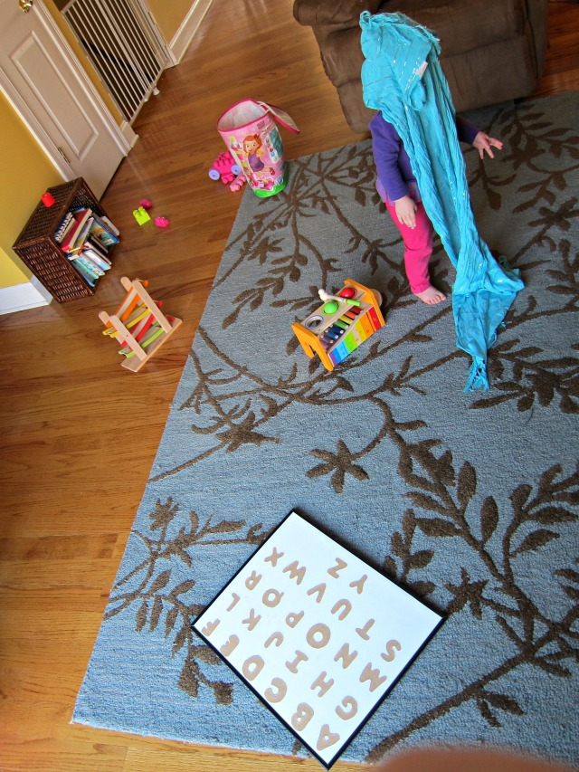 A favorite Peek A Boo scarf that E rediscovered with a music and movement area.