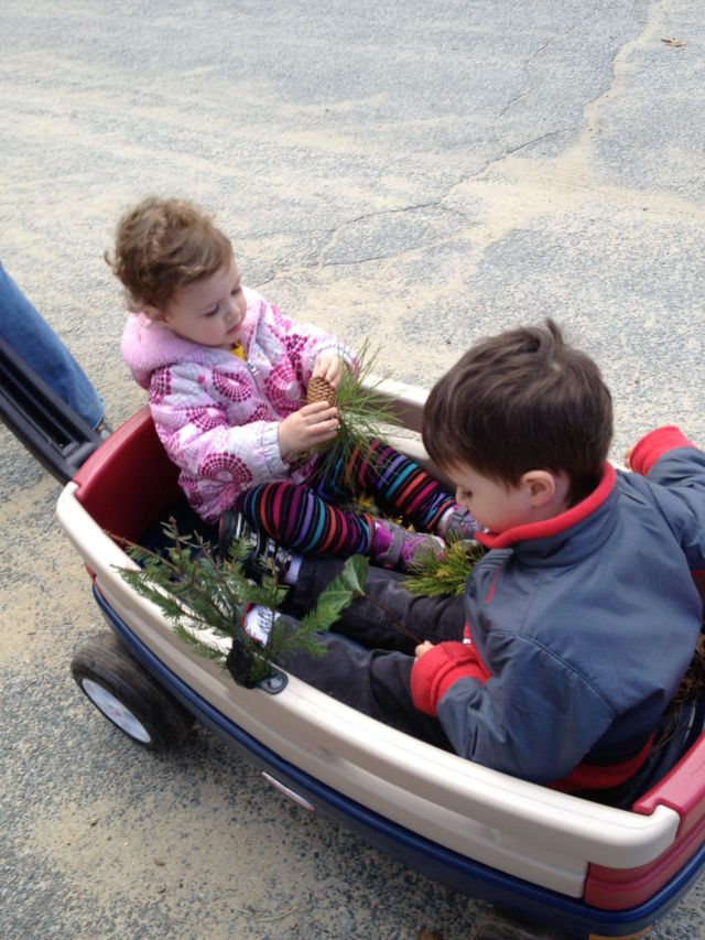 E and her cousin collecting fun finds all over our Wellfleet neighborhood while avoiding ticks via the wagon!