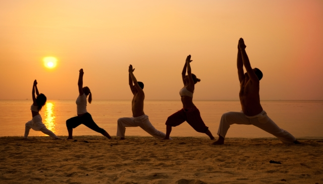 If you're vacationing on the shore, try a beach yoga session. You might even be able to lure others to join you with the promise of a gorgeous sunrise (and some coffee)
