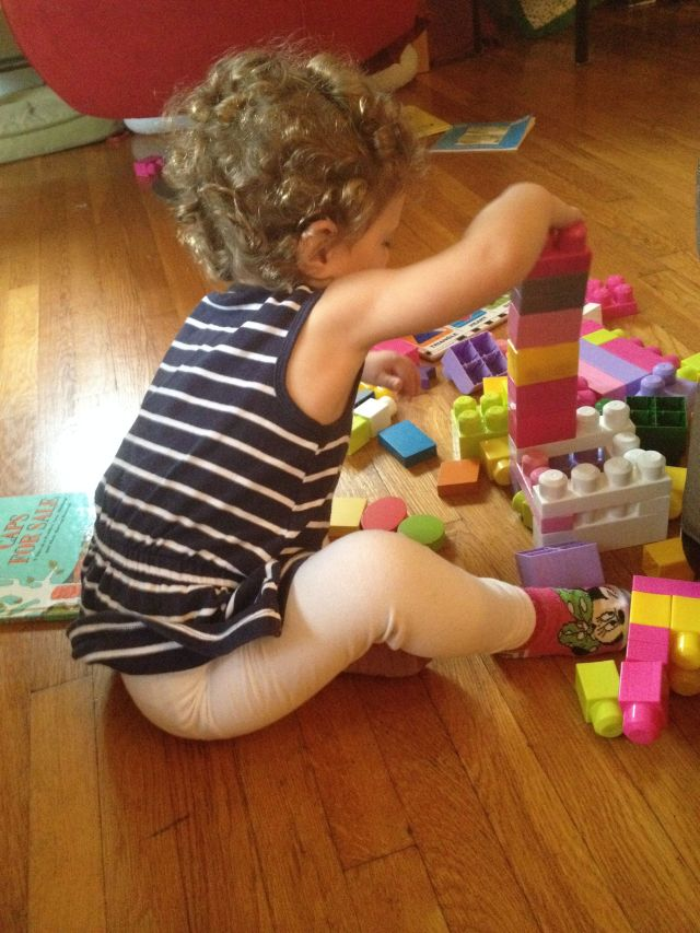 E made a chair out of her blocks, which all four of her baby dolls took turns sitting in followed by herself. She thought this was JUST hysterical. And really, it was kind of amusing.